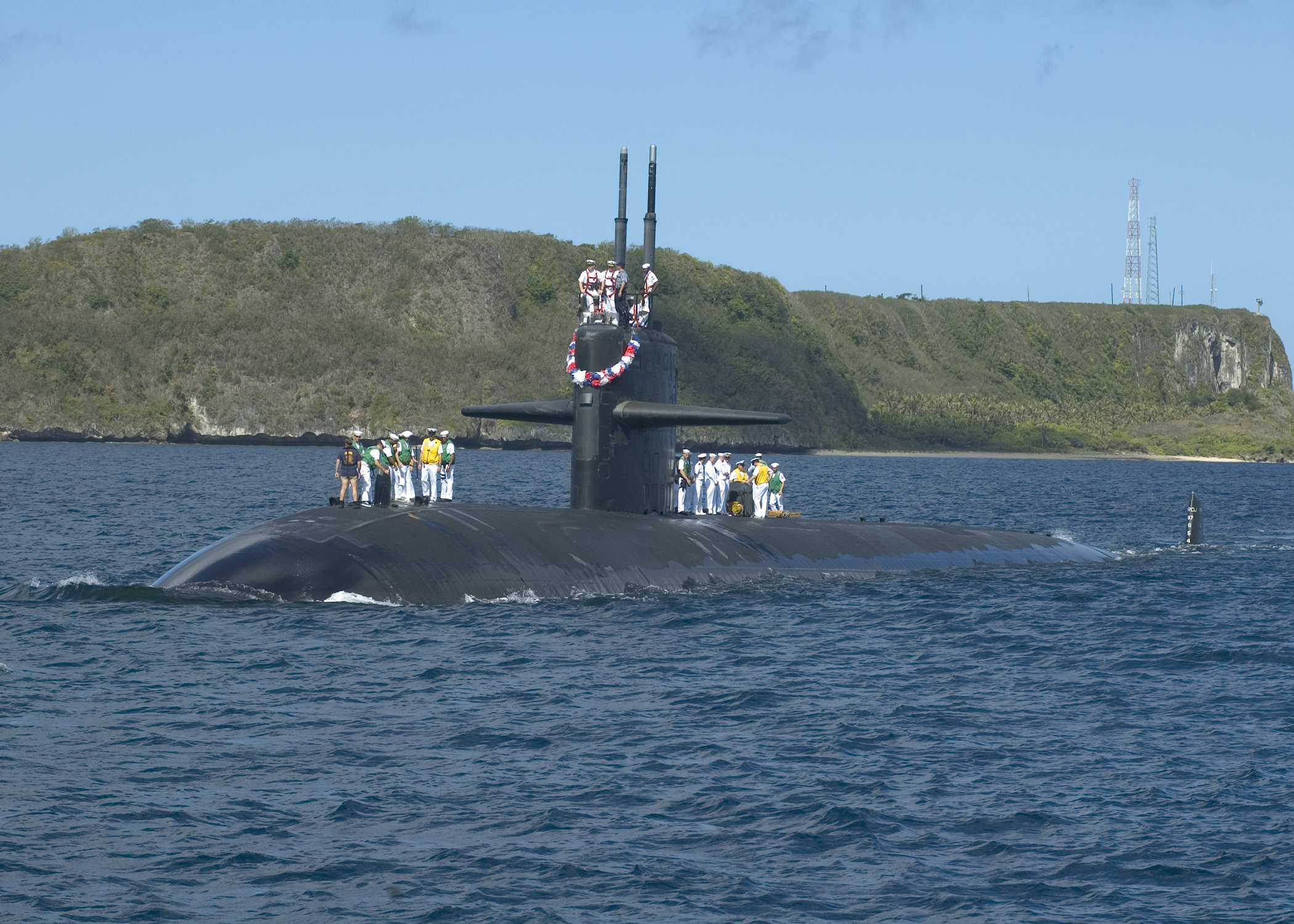 060525-N-9662L-113 Santa Rita, Guam (May 25, 2006) Ð The fast attack submarine USS City of Corpus Christi (SSN 705) sails into Apra Harbor after performing a routine underway. The City of Corpus Christi is currently home ported at Naval Base Guam, and is the 18th Los Angeles-class attack submarine. U.S. Navy photo by PhotographerÕs Mate 2nd Class John F. Looney (RELEASED)