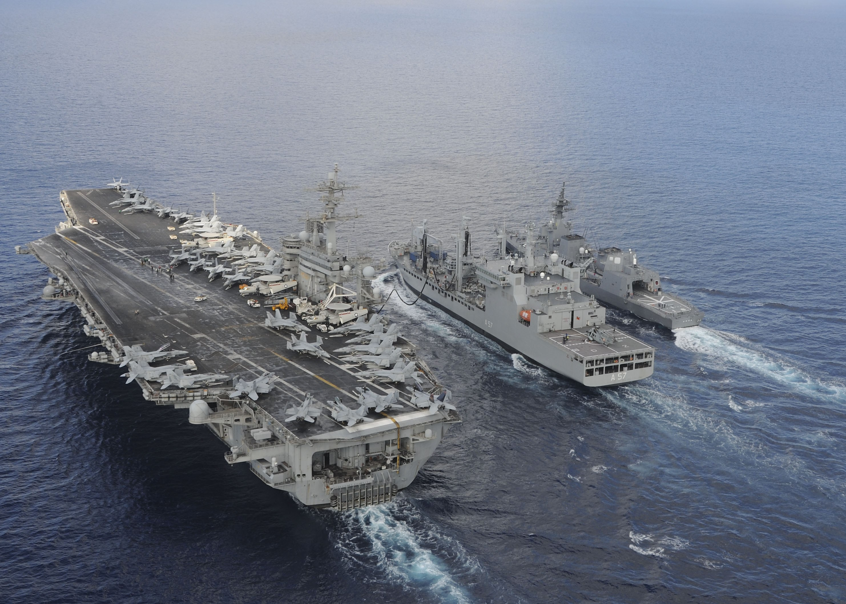 INS Shakti -Indian Navy tanker refueling USS Theodore Roosevelt and Japanese Navy destroyer. Source - Net.