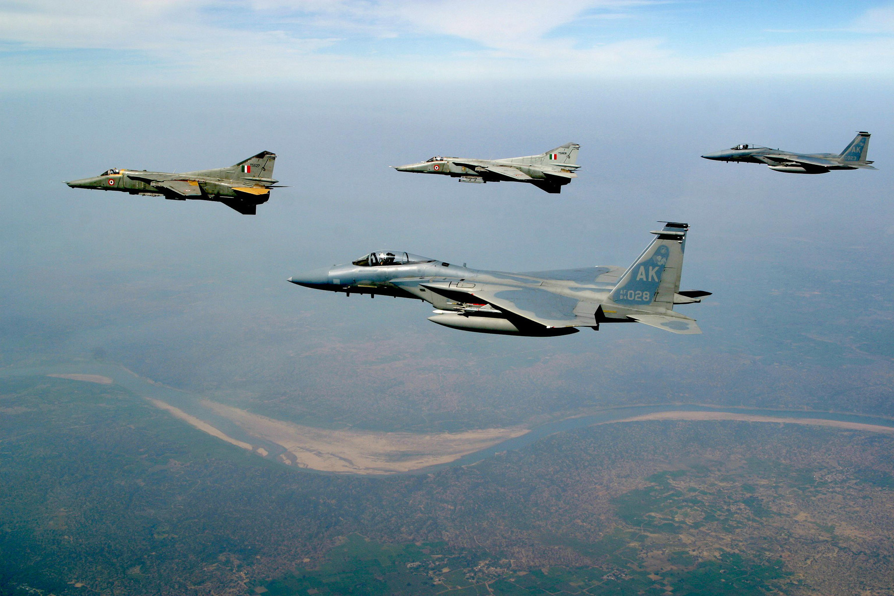 USAF F-15C Eagles from Elmendorf AFB, Alaska and  Indian air force MIG-27 Floggers fly together over the Indian landscape during Cope India 04, the first bilateral fighter exercise between the two air forces in more than 40 years.  The 10-day exercise concluded Feb 25.  (IAF courtesy photo)