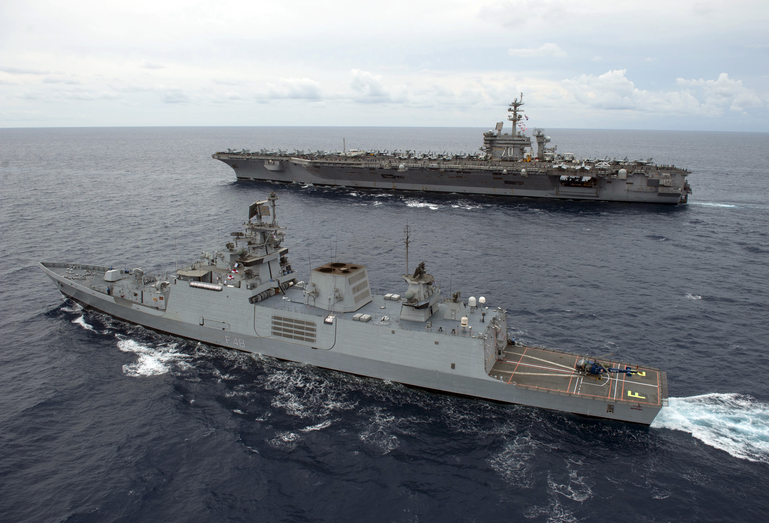 A US Super-carrier sails alongside an Indian stealth Frigate. Source - Net.