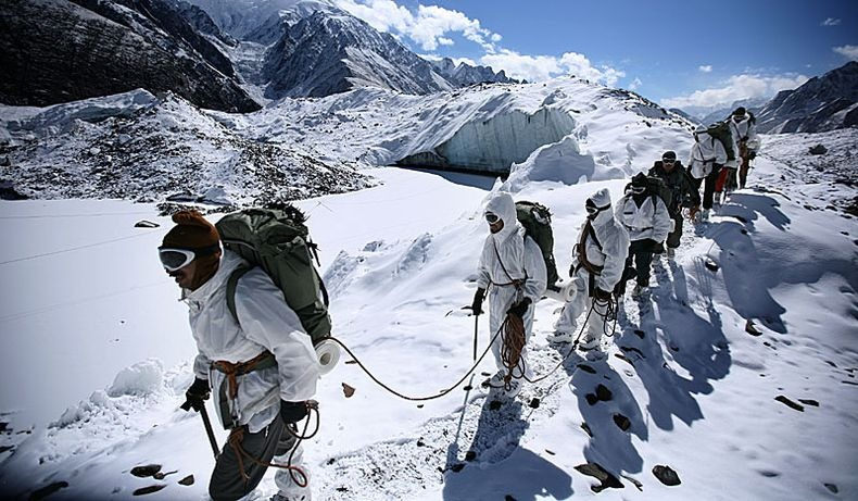 A rope of soldiers as they trek towards the summit. Source - Net.
