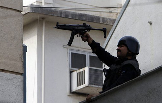A NSG Commando fires towards the terrorist hide-out. Source - Net.
