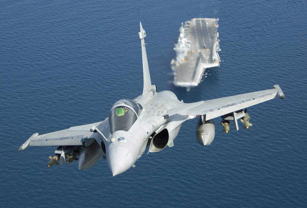 A Rafale-M fighter aircraft taking off from the carrier.