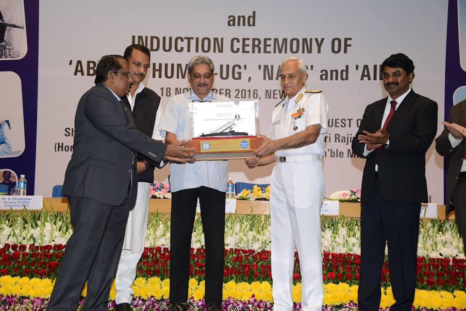 Chairman DRDO Dr S Christopher hands over AIDSS system to Chief of Naval Staff Sunil Lanba in the presence of Defence MInister Manohar Parrikar.