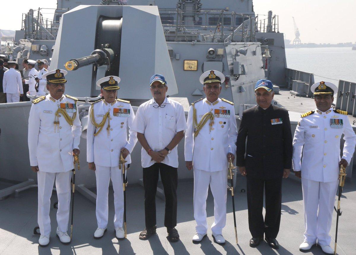 Defence Minister Manohar Parrikar flanked by senior naval officers.
